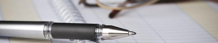 Obrazek slidera - długopis na dokumentach